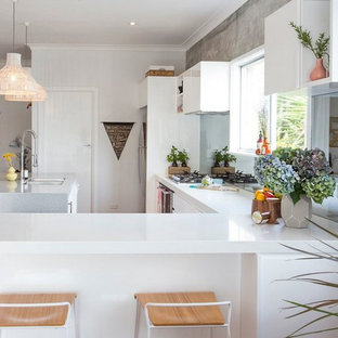 Large scandinavian eat-in kitchen ideas - Inspiration for a large scandinavian l-shaped light wood floor eat-in kitchen remodel in Other with a double-bowl sink, flat-panel cabinets, white cabinets, quartz countertops, white backsplash, glass tile backsplash, stainless steel appliances and an island