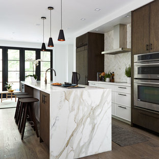 Inspiration for a mid-sized contemporary open plan kitchen in Toronto with an undermount sink, flat-panel cabinets, marble benchtops, marble splashback, with island, dark wood cabinets, dark hardwood floors, brown floor, panelled appliances, beige splashback and beige benchtop.