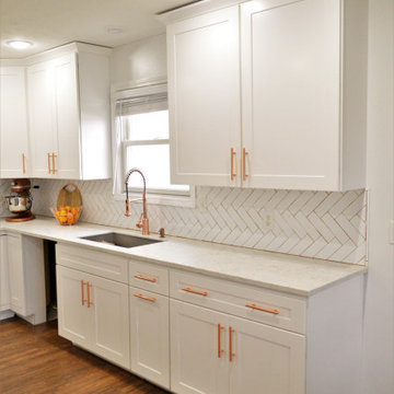 Goshen, IN. BaileyTown USA Select. White Kitchen with Rose Gold Accents