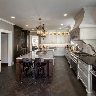 Design ideas for an expansive traditional l-shaped separate kitchen in Cincinnati with an undermount sink, beaded inset cabinets, white cabinets, granite benchtops, multi-coloured splashback, stainless steel appliances, porcelain floors, a peninsula and brown floor.