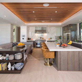 Photo of a large contemporary l-shaped open plan kitchen in Los Angeles with an undermount sink, flat-panel cabinets, stainless steel appliances, with island, grey cabinets, quartz benchtops, white splashback, marble splashback, porcelain floors and beige floor.