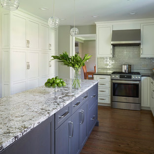 Mid-sized transitional eat-in kitchen designs - Inspiration for a mid-sized transitional galley medium tone wood floor eat-in kitchen remodel in Chicago with white cabinets, quartz countertops, gray backsplash, stainless steel appliances, an island, an undermount sink, recessed-panel cabinets and glass tile backsplash