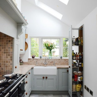 This is an example of a small classic kitchen in Cornwall with a belfast sink.