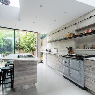 Design ideas for a medium sized scandi single-wall kitchen/diner in London with flat-panel cabinets, grey cabinets, quartz worktops, white splashback, ceramic splashback, concrete flooring, a breakfast bar and grey floors.