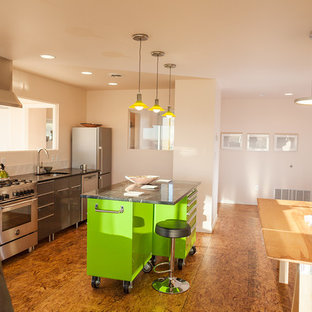 Small contemporary eat-in kitchen designs - Small trendy single-wall plywood floor eat-in kitchen photo in Other with an undermount sink, flat-panel cabinets, gray cabinets, soapstone countertops, white backsplash, ceramic backsplash, stainless steel appliances and an island