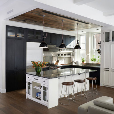Large transitional l-shaped medium tone wood floor open concept kitchen photo in New York with shaker cabinets, black cabinets, quartzite countertops, stainless steel appliances, an integrated sink, white backsplash, ceramic backsplash and an island