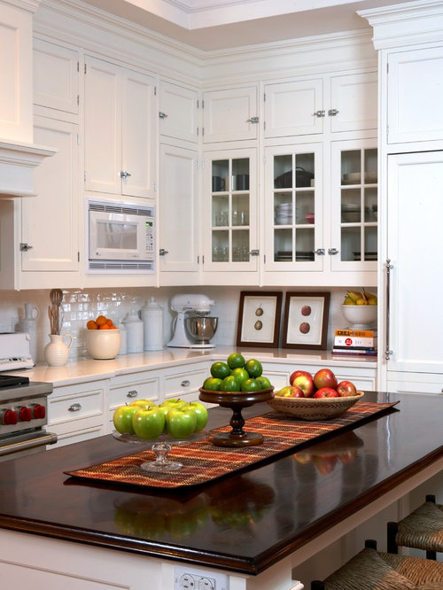 Example of a classic kitchen design in New York with recessed-panel  cabinets, white