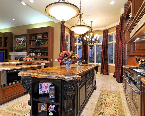 Example Of A Tuscan Open Concept Kitchen Design In Tampa With Granite  Countertops