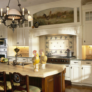 Example of an ornate kitchen design in New York with limestone countertops and limestone backsplash