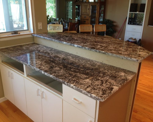 Charming Small Transitional Eat In Kitchen Photo In Other With Granite Countertops,  A Peninsula,