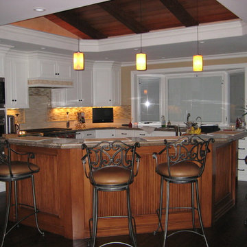 granite, painted cabinets with stained island, vaulted ceiling with false beams