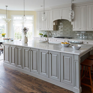 Gray and White Kitchen Cabinets with Clay Tile Backsplash
