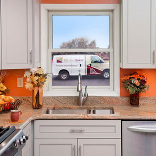 Photo of a small traditional l-shaped enclosed kitchen in Baltimore with a submerged sink, recessed-panel cabinets, white cabinets, granite worktops, stainless steel appliances, ceramic flooring, no island, orange floors and brown worktops.