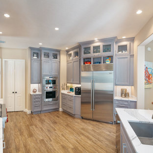 Gray-Stained Walnut Cabinetry Houses Gourmet Appliances