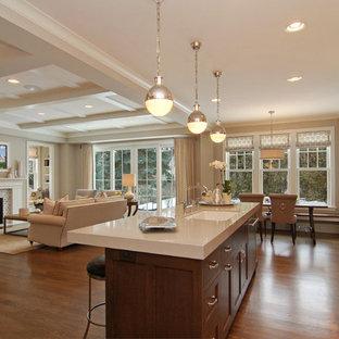 Idee per una cucina ad ambiente unico chic con lavello sottopiano e top bianco