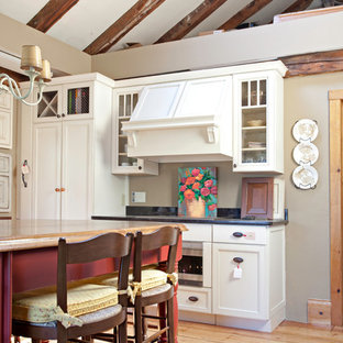Photo of a medium sized country single-wall enclosed kitchen in Boston with a submerged sink, recessed-panel cabinets, white cabinets, granite worktops, plywood flooring and an island.