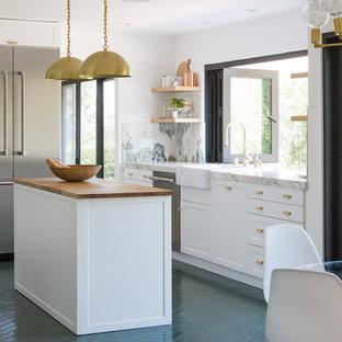 Inspiration for a large contemporary l-shaped separate kitchen in Los Angeles with recessed-panel cabinets, white cabinets, marble benchtops, multi-coloured splashback, marble splashback, stainless steel appliances, brick floors, with island, green floor and green benchtop.