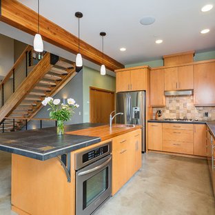 Example of a trendy kitchen design in Seattle with wood countertops