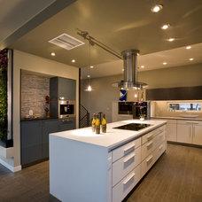 Modern Kitchen by RE.DZINE
