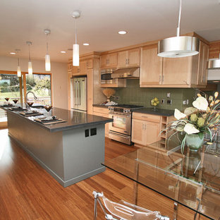 Inspiration for a large contemporary galley open plan kitchen in Seattle with an undermount sink, shaker cabinets, light wood cabinets, zinc benchtops, green splashback, ceramic splashback, stainless steel appliances, medium hardwood floors and with island.