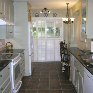 Photo of a small transitional galley separate kitchen in Toronto with an undermount sink, raised-panel cabinets, green cabinets, granite benchtops, white appliances, porcelain floors and no island.