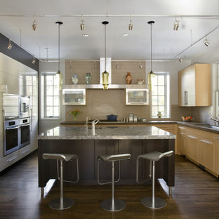 Trendy kitchen photo in Boston with flat-panel cabinets, light wood cabinets, granite countertops, beige backsplash and stainless steel appliances