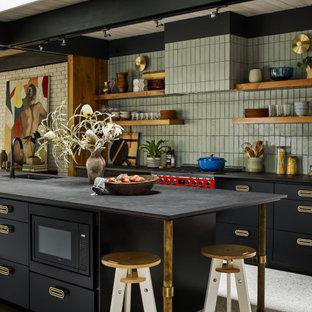 Design ideas for a large midcentury galley open plan kitchen in Atlanta with an undermount sink, black cabinets, green splashback, brick splashback, with island, multi-coloured floor and grey benchtop.