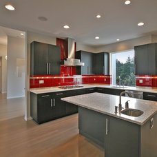 Modern Kitchen by Huggy Bear's Cupboards