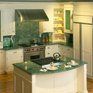 Inspiration for a mid-sized eclectic l-shaped medium tone wood floor enclosed kitchen remodel in New York with recessed-panel cabinets, white cabinets, marble countertops, green backsplash, stone slab backsplash, stainless steel appliances, an island and green countertops