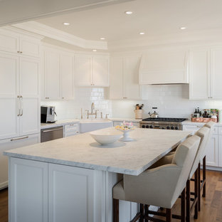 Traditional kitchen ideas - Inspiration for a timeless kitchen remodel in San Francisco with a farmhouse sink, paneled appliances and gray countertops