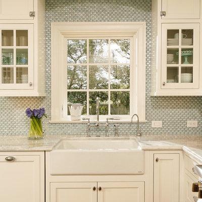 Kitchen - traditional kitchen idea in DC Metro with shaker cabinets, mosaic tile backsplash, a farmhouse sink, quartzite countertops, white cabinets and blue backsplash