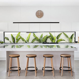 This is an example of a contemporary l-shaped kitchen in Sydney with quartz benchtops, window splashback, black appliances, ceramic floors, with island, grey floor, white benchtop, flat-panel cabinets and white cabinets.