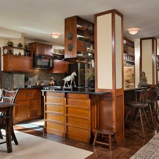 ニューヨークの大きいアジアンスタイルのおしゃれなキッチン (アンダーカウンターシンク、中間色木目調キャビネット、御影石カウンター、緑のキッチンパネル、ボーダータイルのキッチンパネル、黒い調理設備、濃色無垢フローリング) の写真