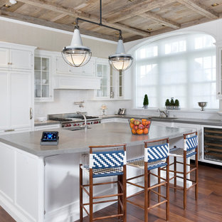 Design ideas for a large traditional l-shaped kitchen in New York with white cabinets, panelled appliances, dark hardwood floors, with island, an undermount sink, beaded inset cabinets, concrete benchtops, white splashback, subway tile splashback and brown floor.
