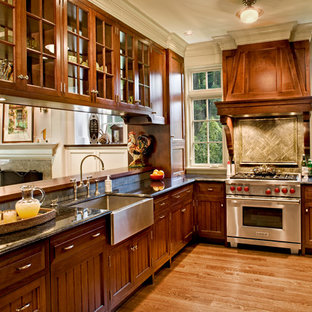 Kitchen - victorian u-shaped medium tone wood floor kitchen idea in Bridgeport with a farmhouse sink, recessed-panel cabinets, medium tone wood cabinets, stainless steel appliances and no island