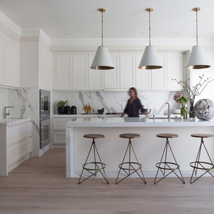 Trendy l-shaped kitchen photo in San Francisco with an undermount sink, shaker cabinets, white cabinets, stainless steel appliances and marble backsplash