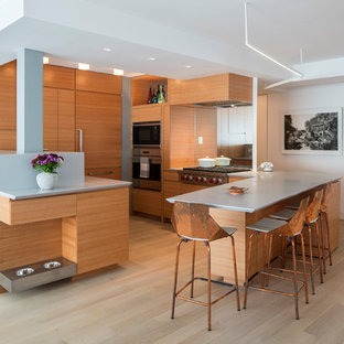 Contemporary kitchen designs - Kitchen - contemporary u-shaped light wood floor and beige floor kitchen idea in New York with flat-panel cabinets, medium tone wood cabinets, mirror backsplash, stainless steel appliances and a peninsula