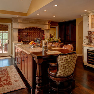 Large traditional kitchen pantry remodeling - Kitchen pantry - large traditional dark wood floor kitchen pantry idea in Denver with raised-panel cabinets, dark wood cabinets, granite countertops, ceramic backsplash, stainless steel appliances, an island, an undermount sink and red backsplash