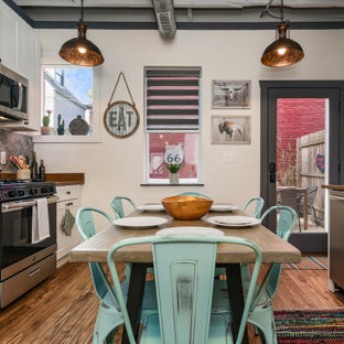 Small industrial eat-in kitchen pictures - Small urban galley dark wood floor and brown floor eat-in kitchen photo in Other with shaker cabinets, white cabinets, gray backsplash, stainless steel appliances, no island and brown countertops