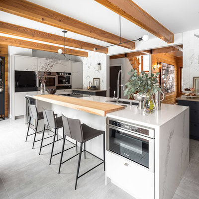 Kitchen - contemporary kitchen idea in Ottawa with an undermount sink, flat-panel cabinets, white cabinets and stainless steel appliances
