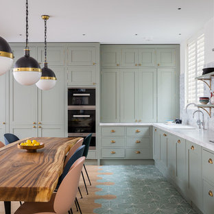 Eat-in kitchen - mid-sized eclectic l-shaped beige floor eat-in kitchen idea in London with an undermount sink, recessed-panel cabinets, gray cabinets, gray backsplash, stainless steel appliances, no island and white countertops