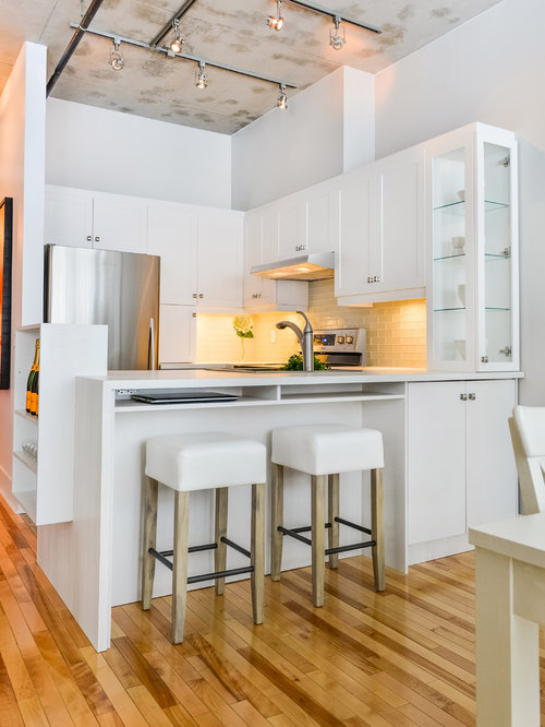 Example Of A Transitional U Shaped Eat In Kitchen Design In Montreal With  Shaker