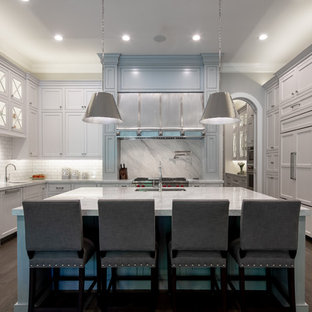 Transitional kitchen designs - Kitchen - transitional u-shaped dark wood floor and brown floor kitchen idea in Houston with shaker cabinets, white cabinets, white backsplash, subway tile backsplash, paneled appliances, an island and white countertops
