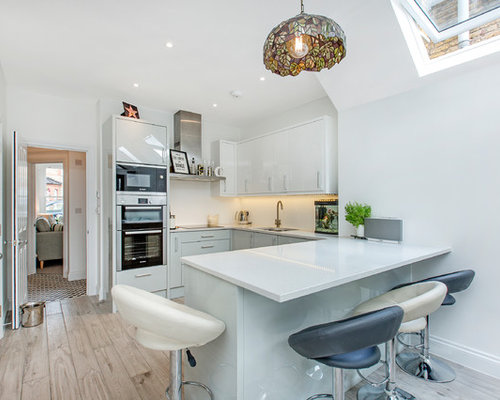 Designs For Small Kitchens. Small contemporary kitchen designs  trendy u shaped photo in London with an Kitchen Peninsulas Houzz