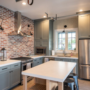 Farmhouse kitchen ideas - Kitchen - farmhouse l-shaped concrete floor and gray floor kitchen idea in Salt Lake City with an undermount sink, recessed-panel cabinets, green cabinets, stainless steel appliances, an island and white countertops