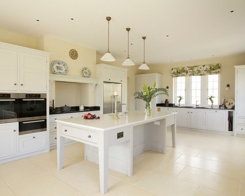 Large farmhouse u-shaped beige floor kitchen idea in Wiltshire with an  undermount sink,