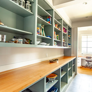 Mid-sized traditional galley kitchen pantry in Vancouver with shaker cabinets, green cabinets, wood benchtops, beige splashback, ceramic floors, grey floor and orange benchtop.