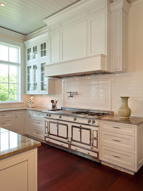 elegant kitchen photo in miami with beaded inset cabinets subway tile backsplash white cabinets