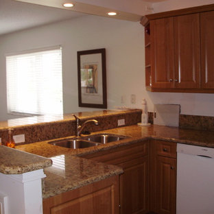 Small southwestern eat-in kitchen photos - Inspiration for a small southwestern l-shaped eat-in kitchen remodel in Other with raised-panel cabinets, brown cabinets, granite countertops, beige backsplash and beige countertops