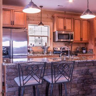 Idéer för mellanstora rustika kök, med en undermonterad diskho, luckor med upphöjd panel, skåp i mellenmörkt trä, granitbänkskiva, rostfria vitvaror och en köksö